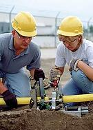 man-and-woman-installing-gas-fuel-line